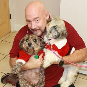 Dr. Hanks with Christmas pups