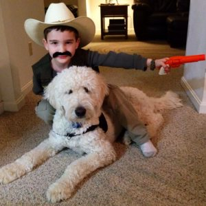 Cowboy and pup friend